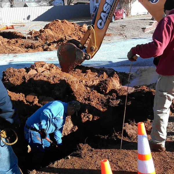 During a directional bore under East Birch Street, our contractors cut into a water line no one knew was there. Workers from the Town of Carnegie work at repairing the line.