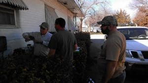 Current Employees (from left) Jimmy Ridgeway, Travis Ridgeway, and Matt Smith work at splicing a customer's house into the new fiber network.