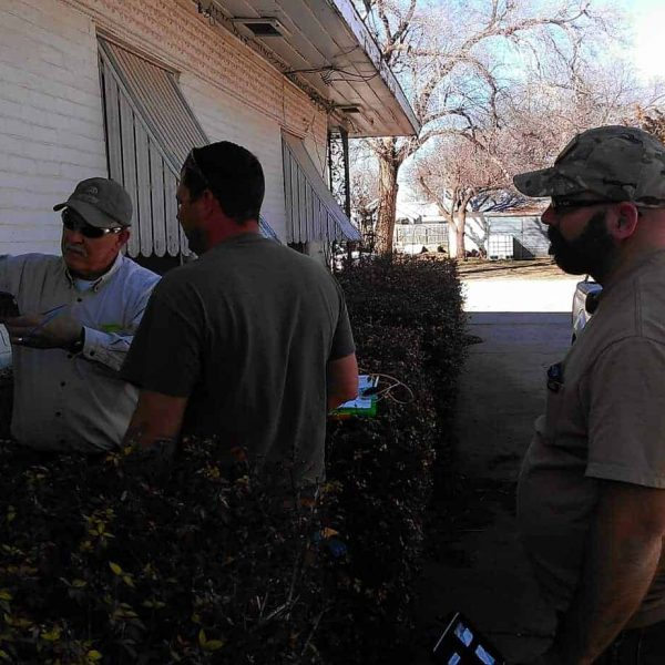 Employees (from left) Jimmy Ridgeway, Travis Ridgeway, and Matt Smith work at splicing a customer's house into the new fiber network.