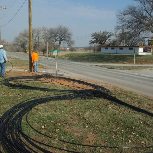These huge lengths of fiber optic cable lay on the ground in a giant