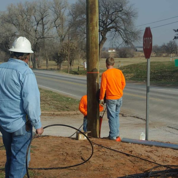 USA Construction Co. employees are placing a new cable under Highway 58 as part of our Fiber Optic Network expansion to the north side of the Washita River. Pictured are Tony Roseberry and Grady Peters. (from l-r)