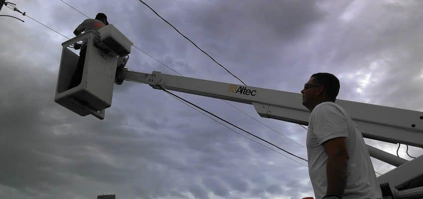 Image of tearing down cables in Carnegie, Oklahoma