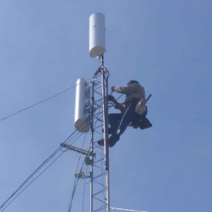 Tower climber Leonard Smith installs some cabling to the radios on top of our new tower south of Fort Cobb Lake
